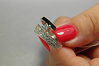 Оригинальное кольцо из серебра 925 с золотом и мелкими фианитами