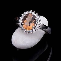 Женское серебряное родированное кольцо с фианитами и цитрином