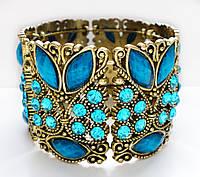 Браслет жесткий под золото, с голубыми камнями «РАЗНОЦВЕТНЫЕ СНЫ»