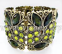 Браслет жесткий под золото, с оливковыми камнями «РАЗНОЦВЕТНЫЕ СНЫ»