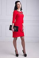 Эффектное женское платье с ассиметричным низом в красном цвете