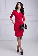 Приталенное платье в красном цвете из коттона с врезными карманами по боках
