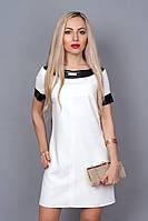 Женское платье со вставками кожи на горловине и манжетах