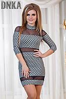 Короткое женское платье со вставками сетки