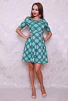 Модное бирюзовое платье с оригинальным вырезом на груди из новой весенней коллекции