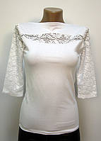 Блуза трикотажная с ажурными вставками белая