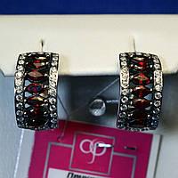 Крупные серебряные серьги с красными камнями Полукольца 21044