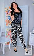 Женские черно-белые брюки с пояском и карманами