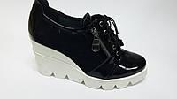 Туфли на танкетке кожаные