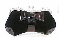 Вечерний велюровый  клатч, черного цвета, декорированный лаковым бантом и стразами