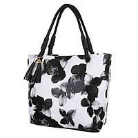 Женская сумка черного цвета с цветочным принтом декором из двух воланов и двумя ручками для переноски