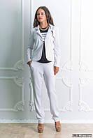 Брючный женский костюм белый