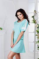 Женский костюм с юбкой спортивного фасона