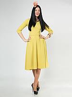 Женское красивое платье миди с карманами, жёлтого цвета.