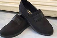 Черные закрытые женские туфли плоской подошве
