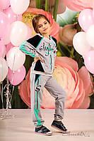 Детский серый трикотажный спортивный костюм на девочку