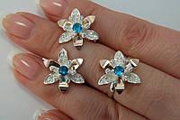 Красивый гарнитур из серебра 925 с голубыми камнями и золотом