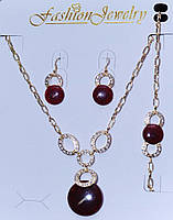 Классический комплект бижутерии с кристаллами и красными камнями