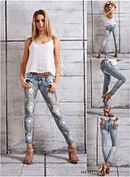 Зауженные джинсы со стразами и вышивкой