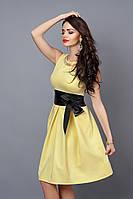 Элегантное женское платье желтого цвета
