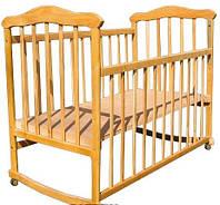 Детская кроватка с колесиками, съемным бортиком и возможностью качания (натуральная ольха)