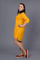 Яркое женское платье желтого цвета
