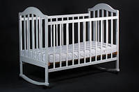Детская кроватка для новорожденных с полозьями для качания, колесиками  белая (древесина ольха)