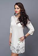 Белое трикотажное платье с перфорацией.Размер :44,46,48,50.