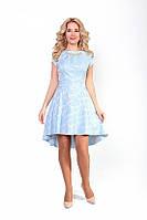 Красивое женское платье с украшением