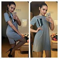 Платье - туника Moschino мини трикотажное с карманом из экокожи SMN165