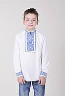 Праздничная вышитая рубашка на мальчика в белом цвете с синим орнаментом