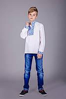 Детская вышитая сорочка с синим орнаментом и длинным рукавом
