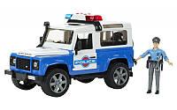 Bruder 02595 машинка - джип Land Rover Defender Station Wagon c фигуркой полицейского