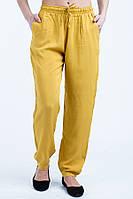 Легкие летние  женские брюки горчичного цвета.
