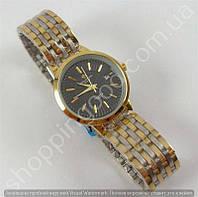 Женские часы Patek Philippe 8276L золотистые с черным циферблатом