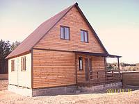 Каркасный деревянный коттедж
