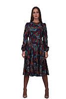 Красивое женское платье-миди с длинными рукавами