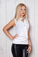 Нарядная летняя блуза белого цвета с украшением