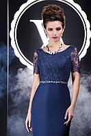 Грациозное вечернее платье с ажурной открытой спинкой