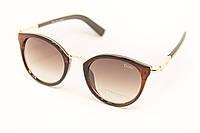 Женские очки в коричневой оправе