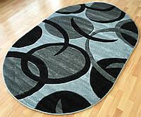 Стриженный ковер - полипропилен   овальной формы черно-серых тонов