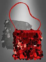 Красная блестящая сумка