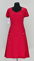 Платье оригинальными декорированными карманами