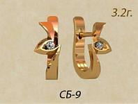 Необычные золотые серьги с центральным камнем круглой формы
