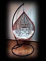 Подвесное кресло-кокон Nest из ротанга коньячного цвета со стойкой