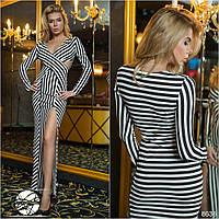 Оригинальное вечернее платье с запахом и разрезом выше колена.