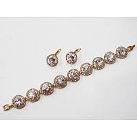 Набор украшений серьги и браслетик в золоте с роскошными прозрачными кристаллами в миниатюрных стразах