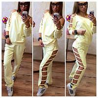 Женский спортивный костюм с вырезами по ноге в расцветках мод.014