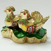 Уточки мандаринки-талисман, символизирующий супружескую верность, приносящий благополучие, удачу и процветание