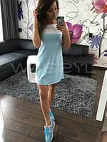 Короткое двухцветное женское платье с короткими рукавами